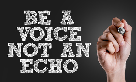 Hand writing the text: Be a Voice Not An Echo
