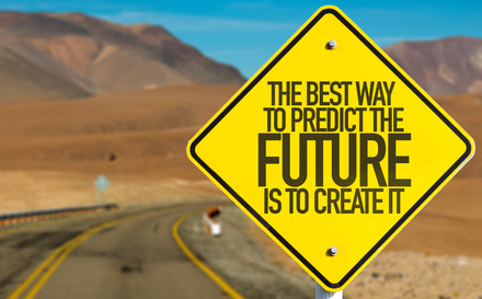 The Best Way To Predict The Future Is To Create It sign on desert road